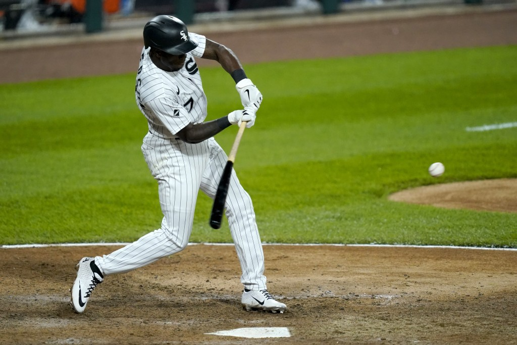 Chicago White Sox's Tim Anderson swings into an RBI-double off Minnesota Twins relief pitcher Taylor Rogers during the eighth inning of a baseball gam...