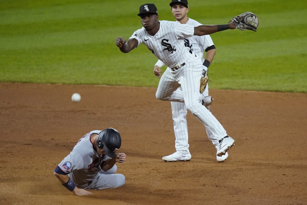Chicago White Sox shortstop Tim Anderson, center, turns a double play, forcing out Minnesota Twins' Max Kepler, left, at second base and getting Josh ...