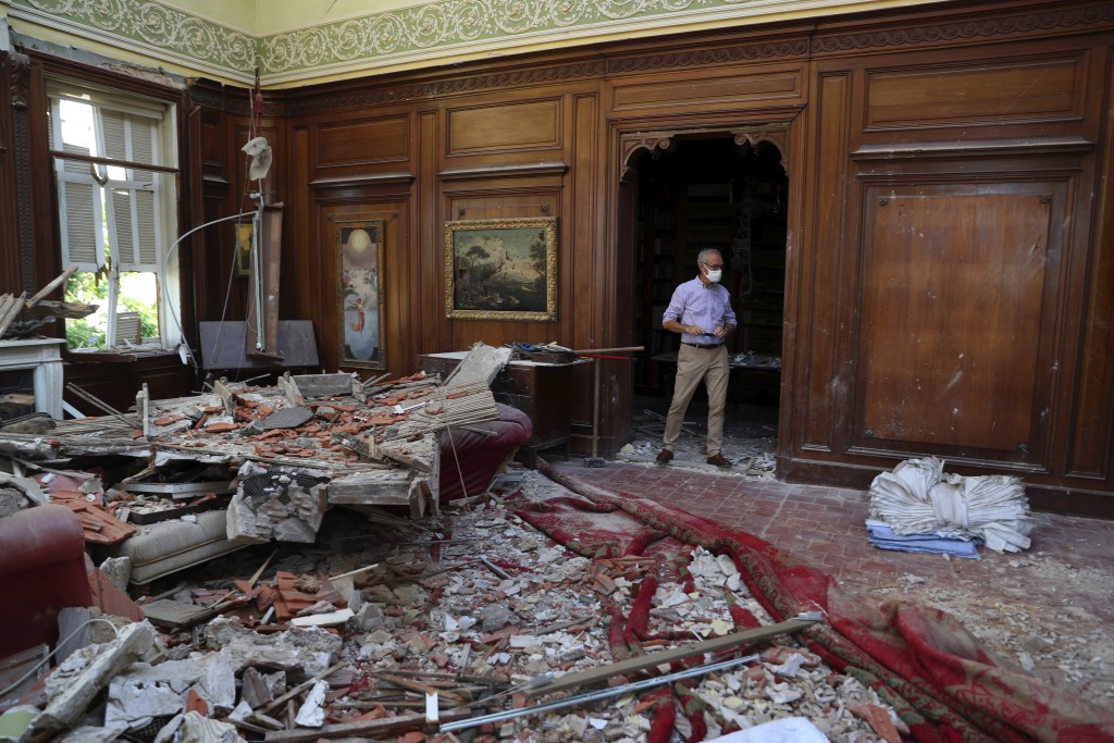 A member of a non-governmental international organizations dedicated to the conservation of the world's monuments and sites inspects a room of the 150...