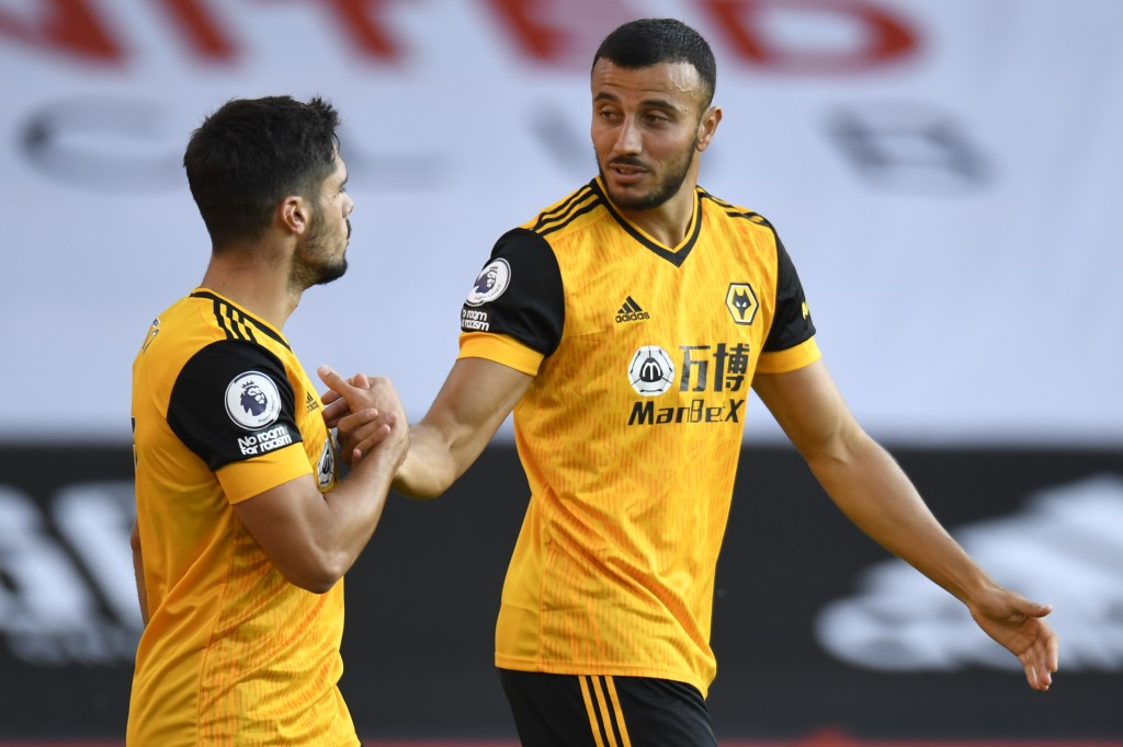 Wolverhampton Wanderers' Romain Saiss, right, celebrates scoring his sides second goal during the English League Cup soccer match between Sheffield Un...