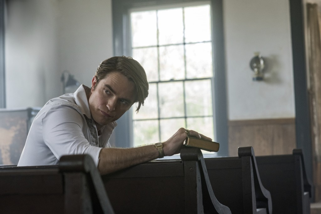 "This image released by Netflix shows Robert Pattinson in a scene from ""The Devil All The Time."" (Glen Wilson/Netflix via AP)"