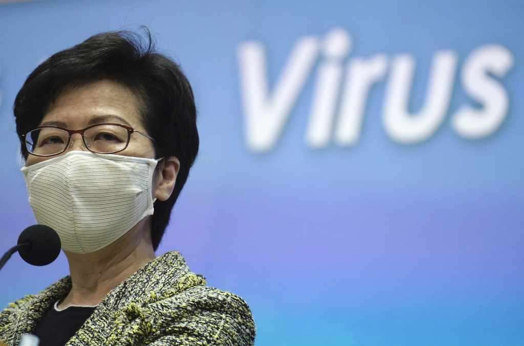Hong Kong Chief Executive Carrie Lam listens to reporters' questions during a press conference in Hong Kong, Tuesday, Sept. 15, 2020. Lam said Tuesday...