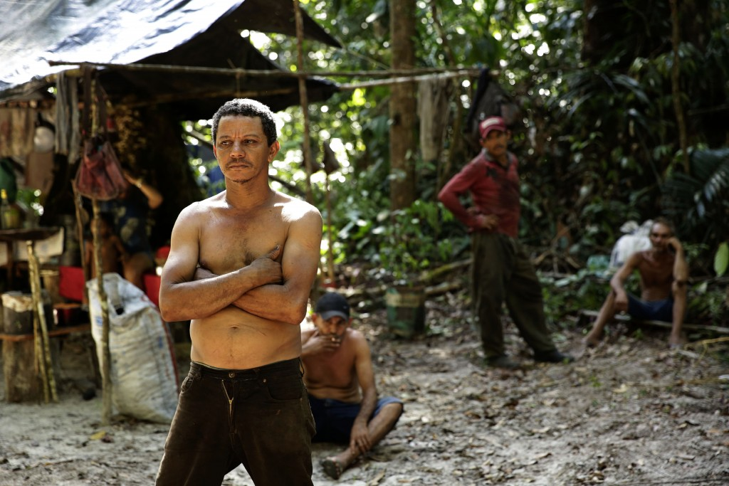 Zeca Pilao, leader of an illegal logger camp, talks with Tenetehara Indigenous men from the Ka'Azar, or Forest Owners, who discovered the encampment w...