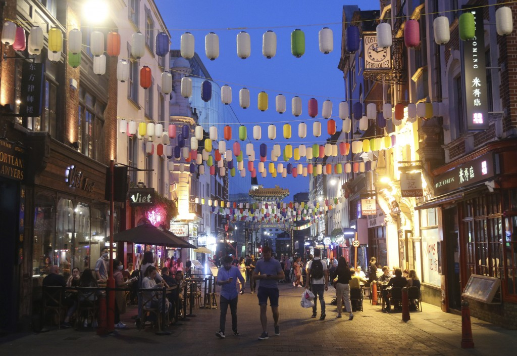 People drink and dine out in Chinatown, London, Monday Sept. 14, 2020. New rules preventing gatherings of more than six people go into effect in Engla...