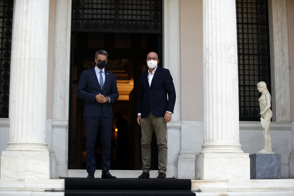 Greece's Prime Minister Kyriakos Mitsotakis, left, and European Council President Charles Michel pose at Maximos Mansion in Athens, Tuesday, Sept. 15,...