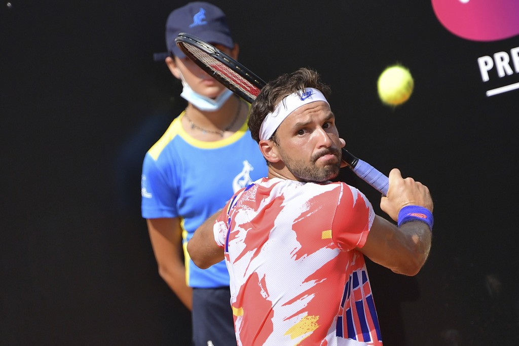 Buglaria's Grigor Dimitrov returns the ball to Italy's Gianluca Mager during their match at the Italian Open tennis tournament, in Rome, Monday, Sept....