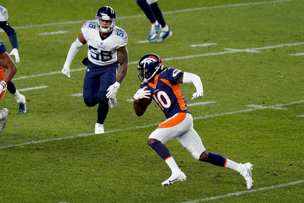 Denver Broncos wide receiver Jerry Jeudy (10) runs the ball as Tennessee Titans linebacker Harold Landry (58) pursues during the first half of an NFL ...
