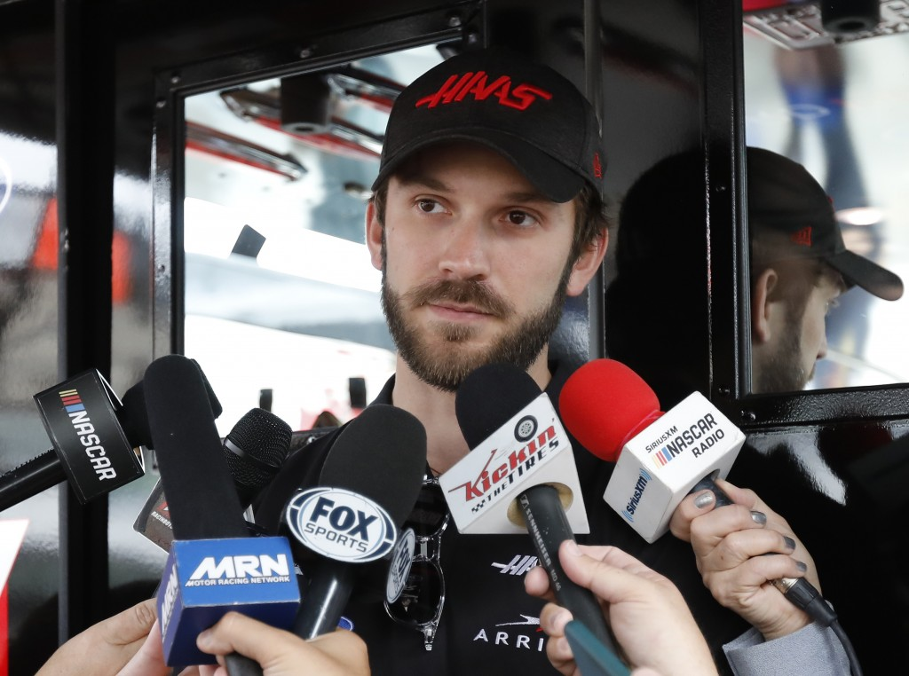 FILE - Daniel Suarez talks to the media before practice for a NASCAR Cup Series auto race on Friday, Nov. 15, 2019, at Homestead-Miami Speedway in Hom...