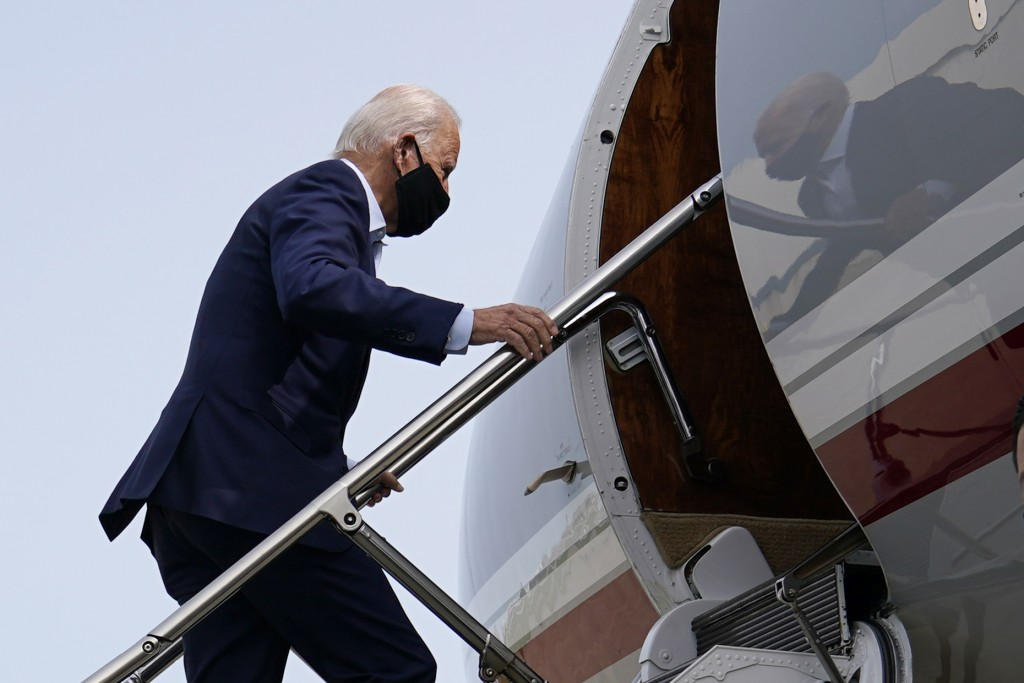 Democratic presidential candidate and former Vice President Joe Biden boards a plane at New Castle Airport in New Castle, Del., Tuesday, Sept. 15, 202...