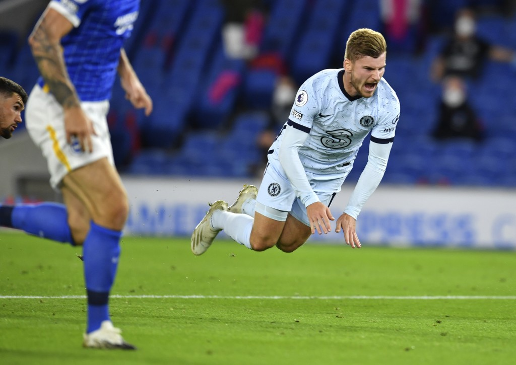 Chelsea's Timo Werner reacts after he is fouled by Brighton's goalkeeper Mathew Ryan during the English Premier League soccer match between Brighton a...
