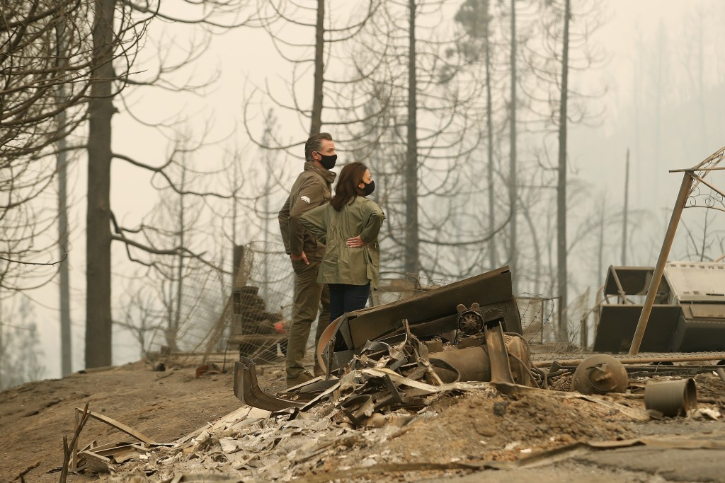 California Gov. Gavin Newsom and Democratic vice presidential candidate Sen. Kamala Harris, D-Calif., talk as they asses the damage during the Creek F...