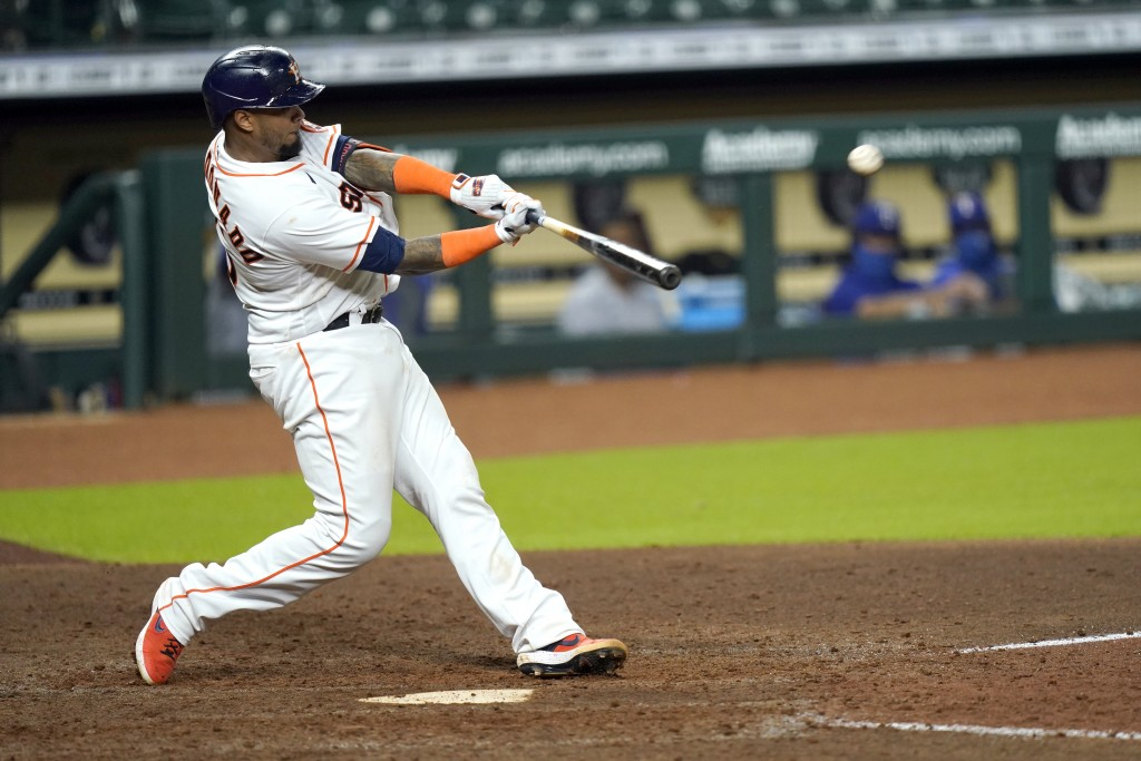 Houston Astros' Martin Maldonado hits a home run against the Texas Rangers during the eighth inning of a baseball game Tuesday, Sept. 15, 2020, in Hou...