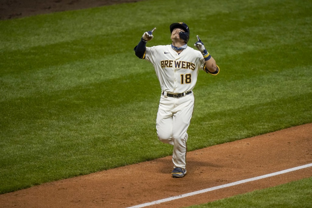 Milwaukee Brewers' Keston Hiura celebrates after hitting a three-run home run during the fourth inning of a baseball game against the St. Louis Cardin...