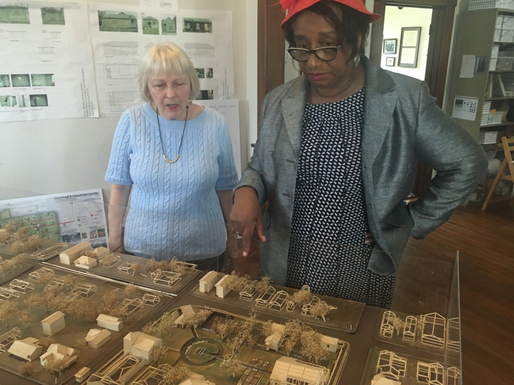 In this Sept. 27, 2017 photo, Freedmen's Town Preservation Coalition president Dorris Ellis Robinson, right, and Catherine Roberts, left, look over a ...