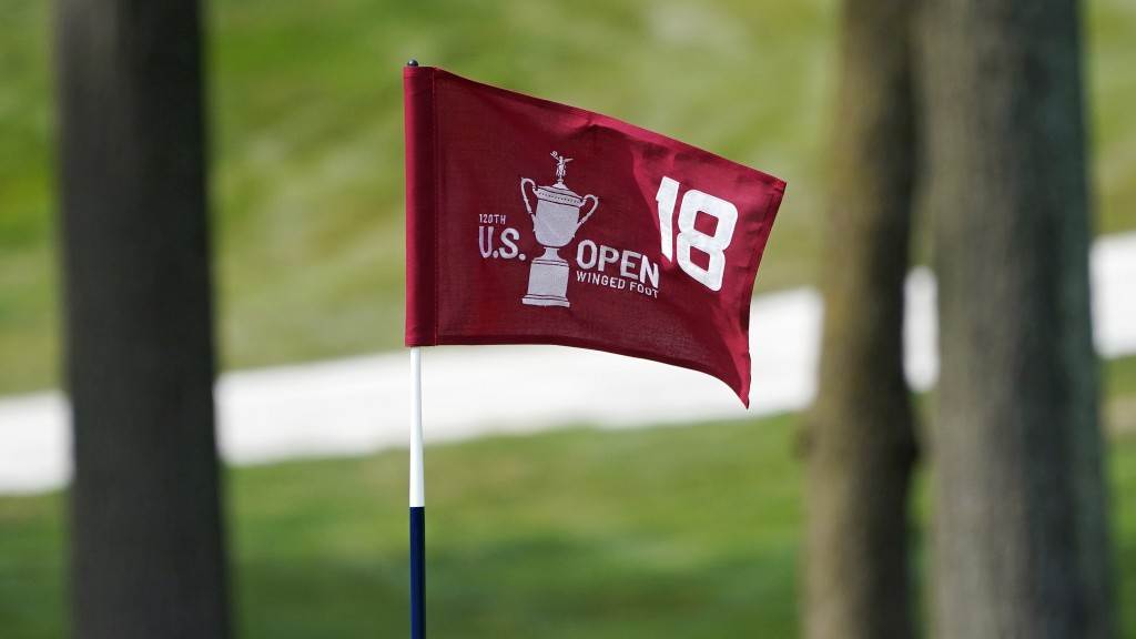 The pin flag for the 18th green flutters in the afternoon breeze during a practice round before the U.S. Open Championship golf tournament, Tuesday, S...