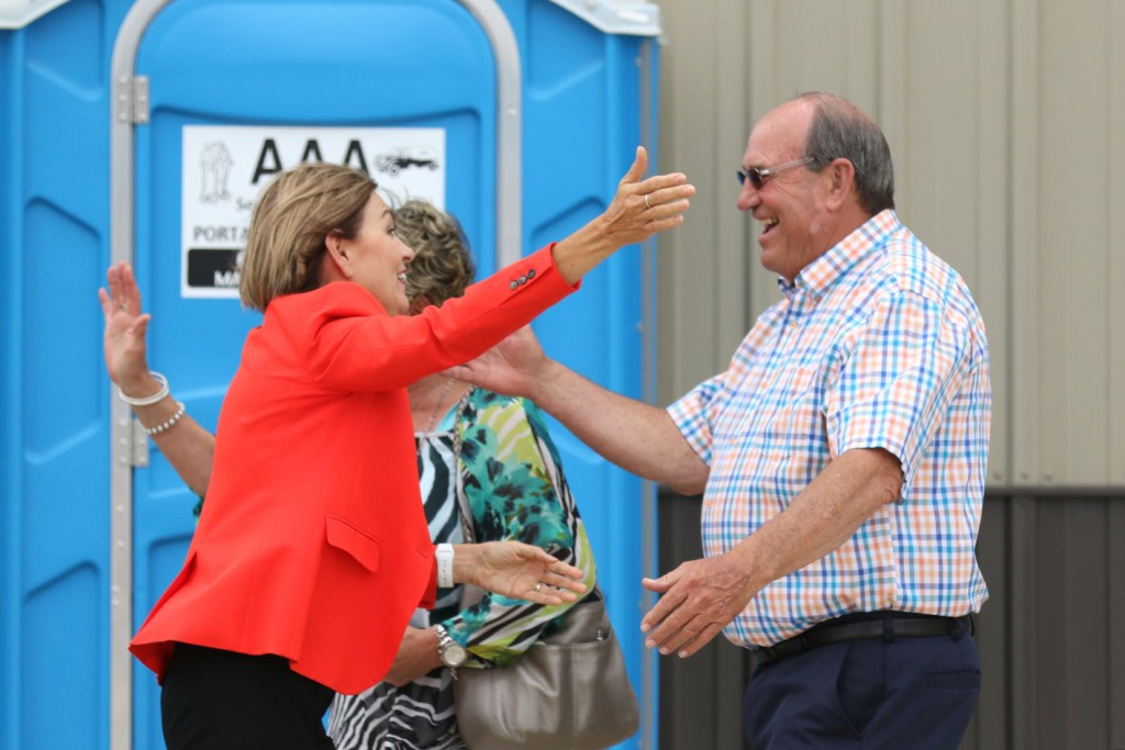 In this Aug. 7, 2020 photo provided by the Iowa Falls Times Citizen, Iowa Gov. Kim Reynolds greets people at the Hardin County GOP Sweet Corn Feed in ...