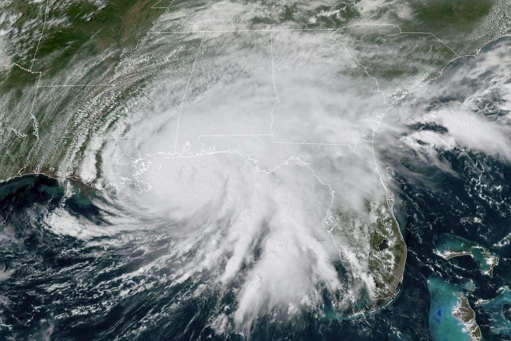 This GOES-16 GeoColor satellite image taken Tuesday, Sept. 15, 2020, at 3 p.m. EDT., and provided by NOAA, shows Hurricane Sally moving slowly towards...