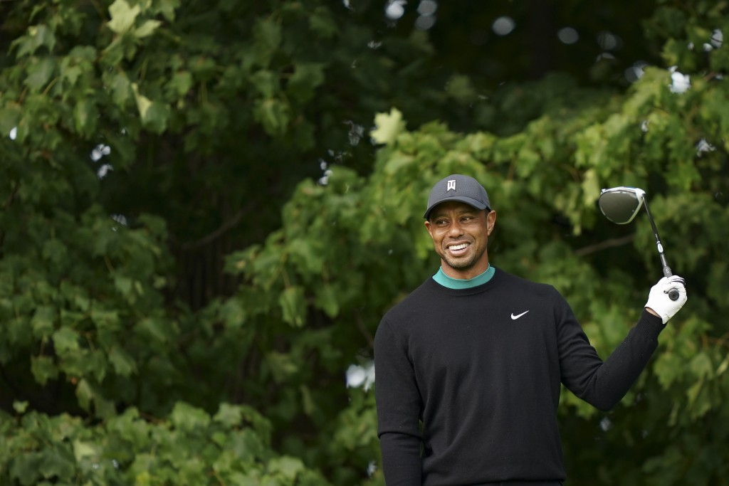 Tiger Woods smiles on the 12th tee during practice for the U.S. Open Championship golf tournament at Winged Foot Golf Club, Tuesday, Sept. 15, 2020, i...