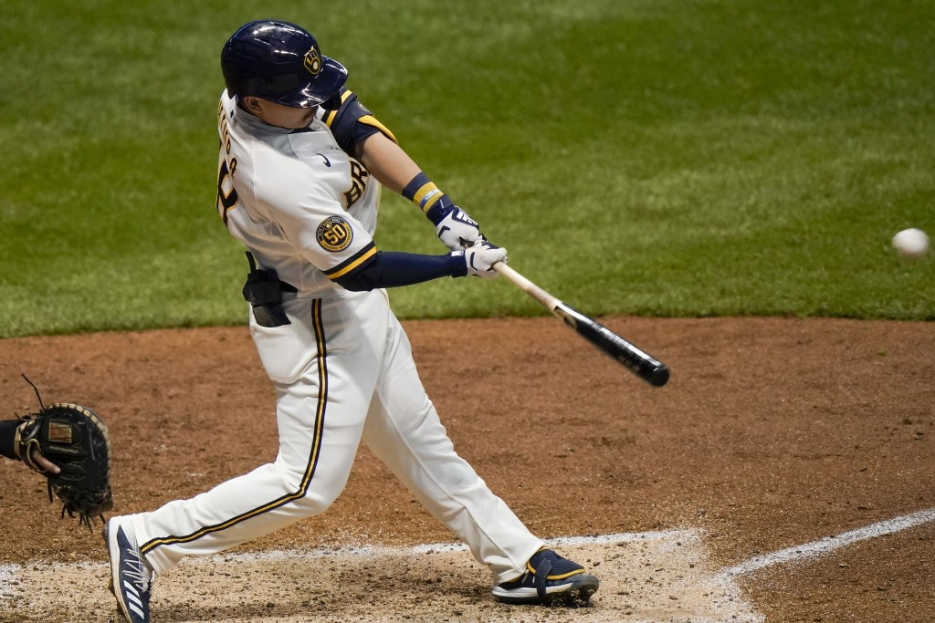 Milwaukee Brewers' Keston Hiura hits a three-run home run during the fourth inning of a baseball game against the St. Louis Cardinals Tuesday, Sept. 1...