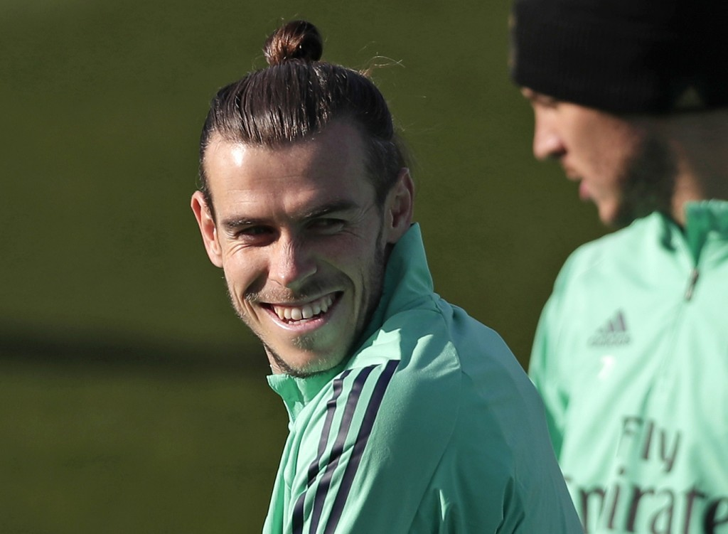 FILE - In this Monday, Nov. 25, 2019 file photo, Real Madrid's Gareth Bale takes part in a training session at the team's Valdebebas training ground i...