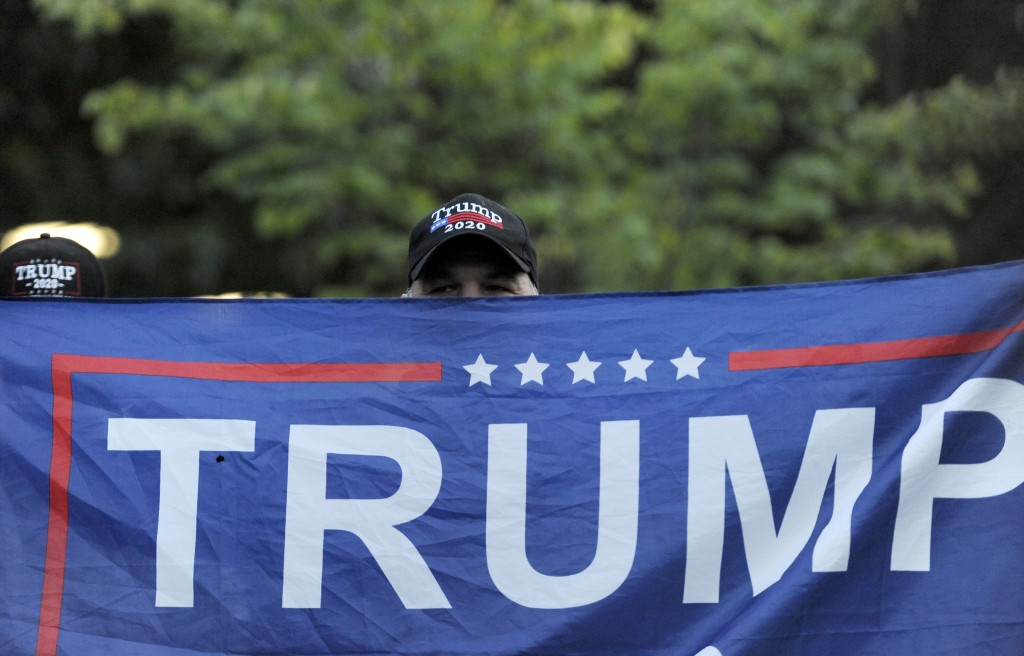 A person holds up a Trump flag at Independence Mall to support U.S. President Donald Trump as he visits the National Constitution Center to participat...