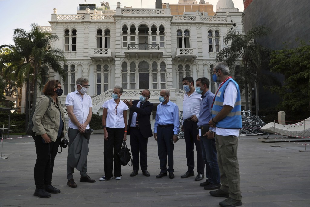 Members of non-governmental international organizations dedicated to the conservation of the world's monuments and sites, stand in front of the Sursoc...