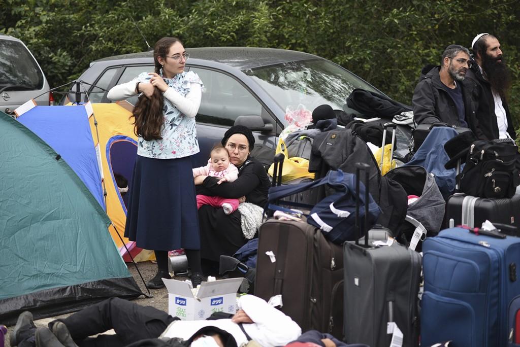 Jewish pilgrims gather on the Belarus-Ukraine border, in Belarus, Tuesday, Sept. 15, 2020. About 700 Jewish pilgrims are stuck on Belarus' border due ...