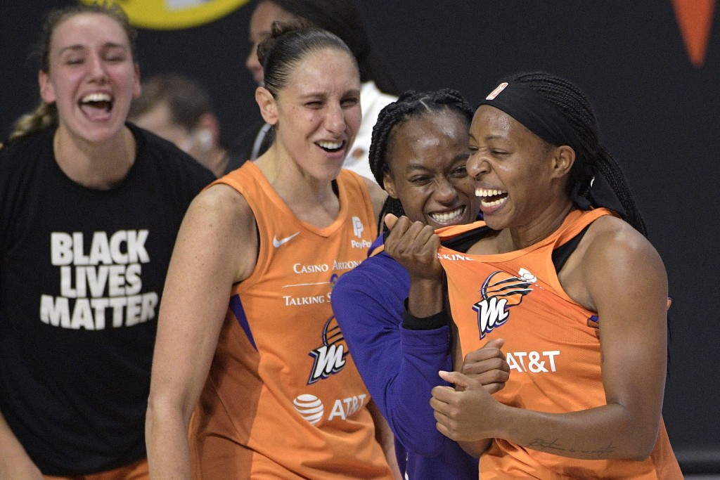 Phoenix Mercury guard Shey Peddy, right, is congratulated by guard Shatori Walker-Kimbrough, second from right, guard Diana Taurasi and forward Alanna...