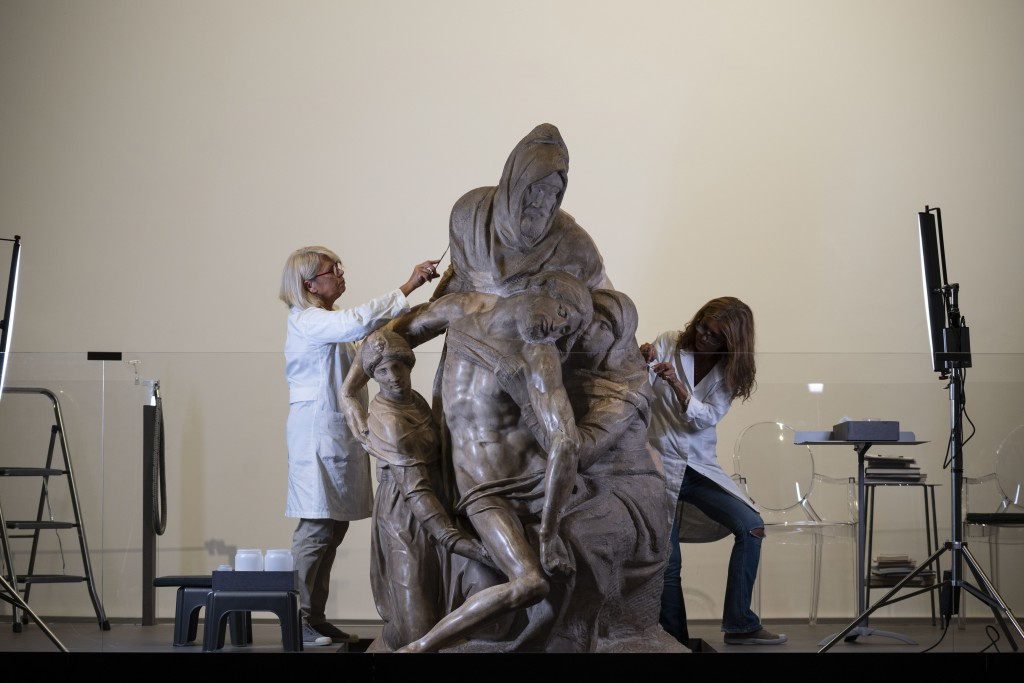 Restorers work on one of Michelangelo's Pieta sculpture in Florence, Italy, Tuesday, Sept. 8, 2020. A restoration of one of Michelangelo's Pieta sculp...