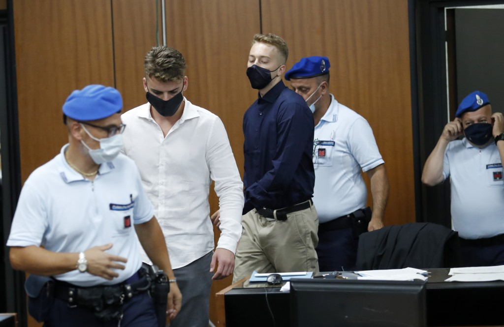 Gabriel Natale-Hjorth, second from left, and Finnegan Lee Elder, from California, arrive in court for a hearing in their trial where they are accused ...