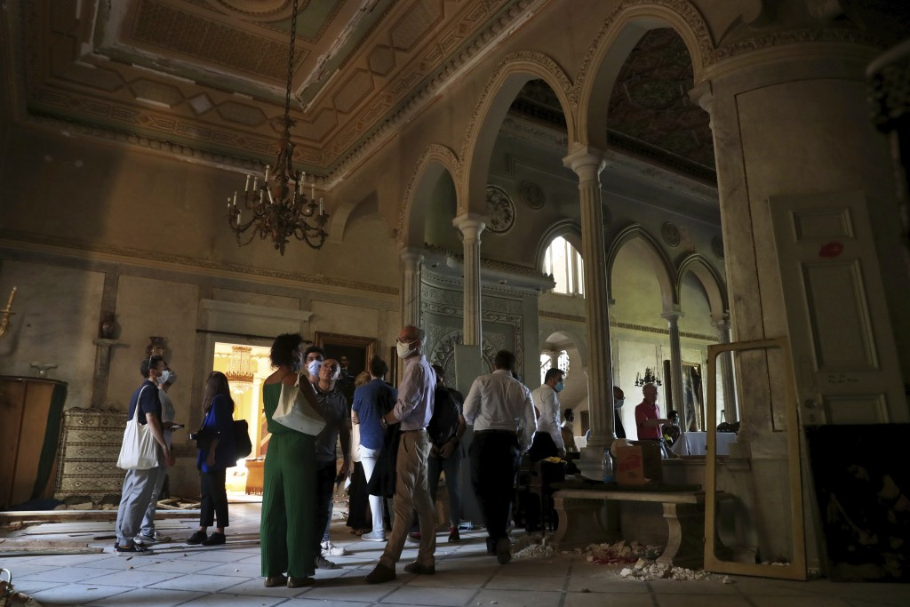 Members of non-governmental international organizations dedicated to the conservation of the world's monuments and sites, inspect a room of the 150-ye...