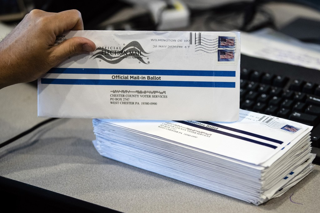FILE - In this May 28, 2020, file photo, mail-in primary election ballots are processed at the Chester County Voter Services office in West Chester, P...