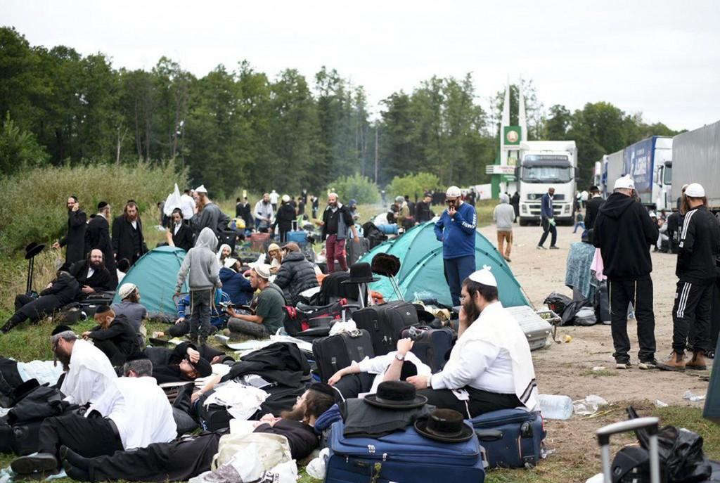 Jewish pilgrims sit on the Belarus-Ukraine border, in Belarus, Tuesday, Sept. 15, 2020. About 700 Jewish pilgrims are stuck on Belarus' border due to ...