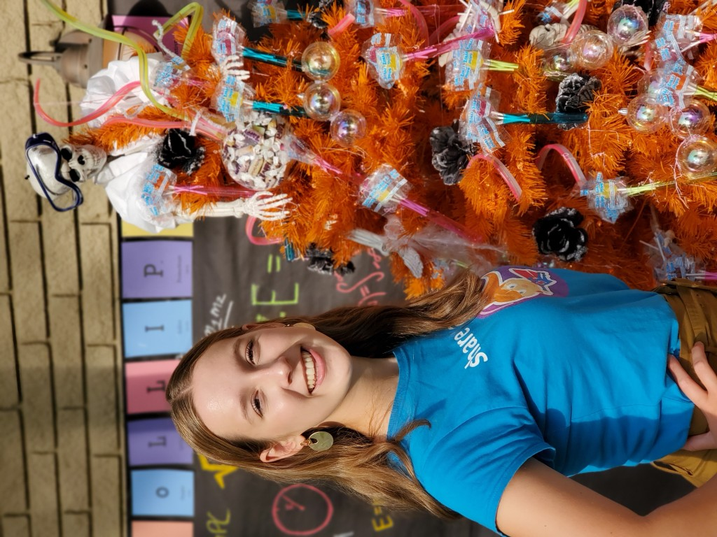 This mage released by Zolli Candy shows 15-year-old candy entrepreneur Alina Morse posing next to a decorated tree for Halloween. The family holiday s...