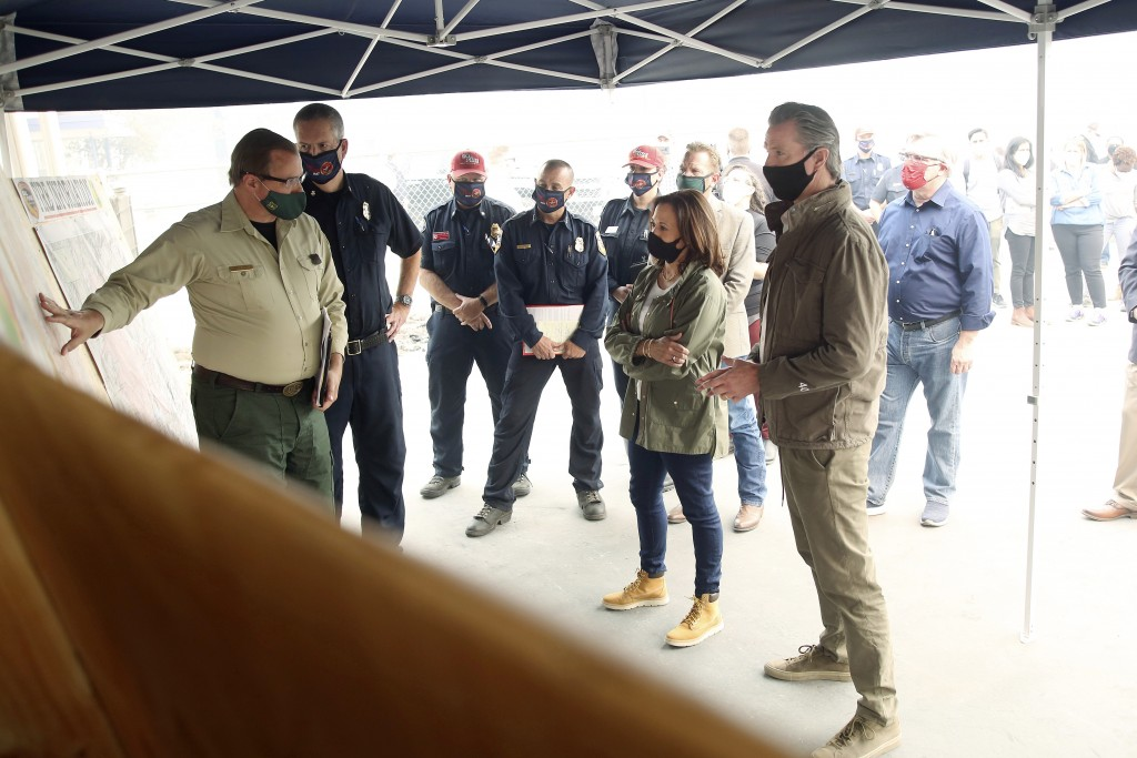 Democratic vice presidential candidate Sen. Kamala Harris, D-Calif., and California Gov. Gavin Newsom are briefed on the damage during the Creek Fire ...