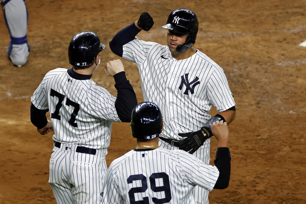 New York Yankees' Gary Sanchez celebrates hitting a three-run home run with Clint Frazier (77) and Gio Urshela (29) during the fourth inning of a base...