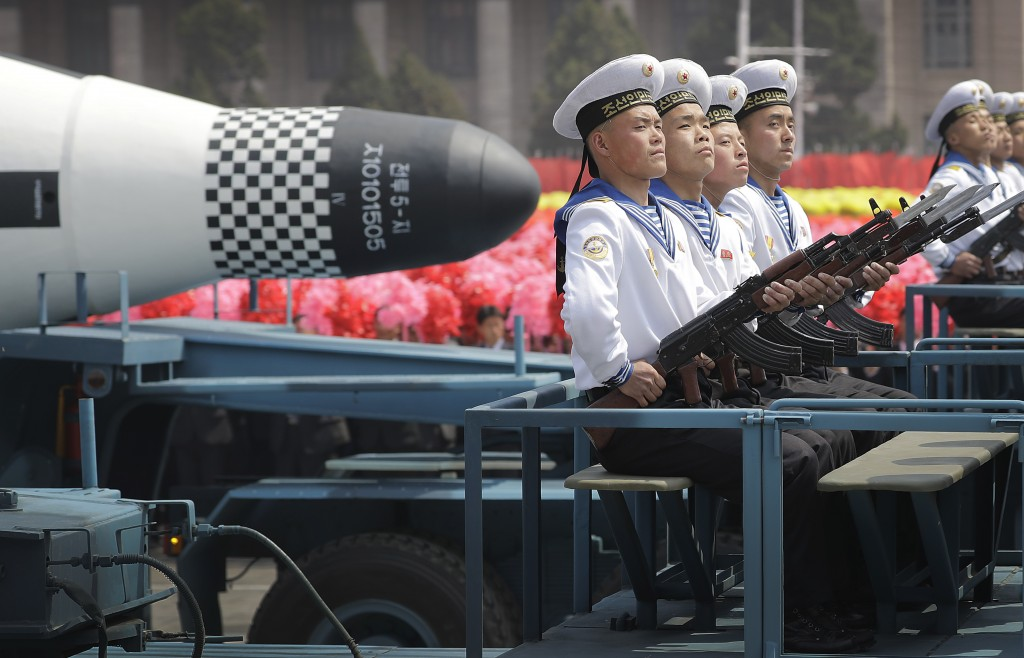 """FILE - In this April 15, 2017, file photo, navy personnel sit in front of a submarine-launched """"Pukguksong"""" ballistic missile (SLBM) as it is paraded ..."""