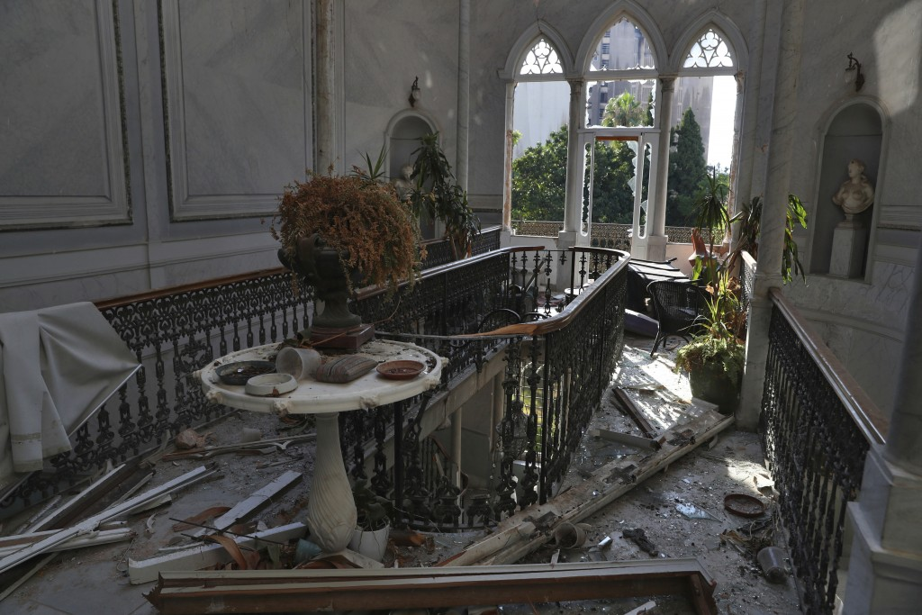 Broken glass and window frames lay on the floor of the 150-year-old Sursock Palace that was damaged by the Aug. 4 explosion that hit the seaport of Be...