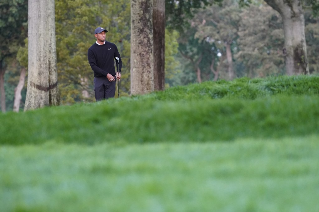 Tiger Woods watches his shot from the third fairway during practice before the U.S. Open Championship golf tournament at Winged Foot Golf Club, Wednes...