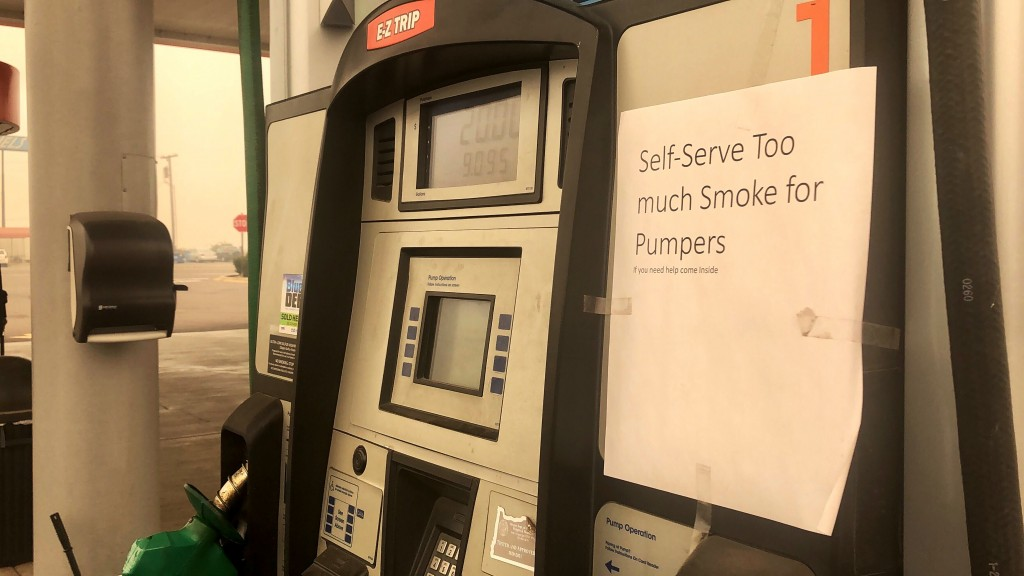 A sign on a pump at a gas station on Interstate 5 in Marion County, Oregon, announces that it is closed on Friday, Sept. 11, 2020. People across the W...