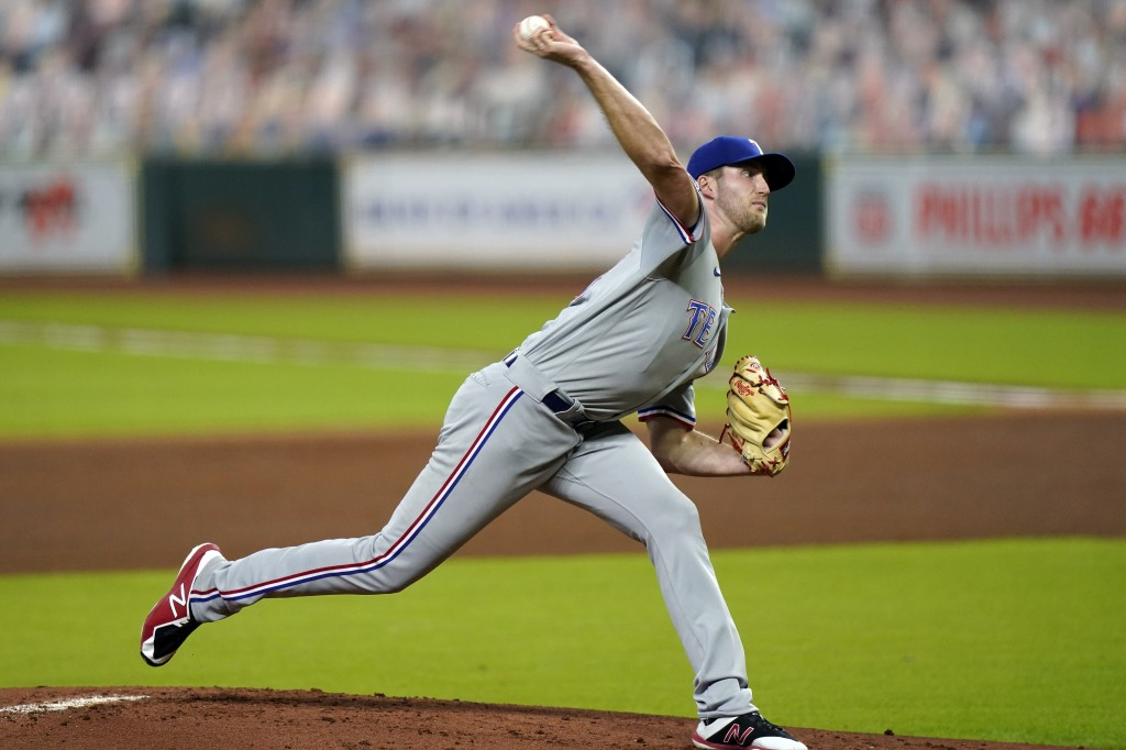 Texas Rangers starting pitcher Kyle Cody throws against the Houston Astros during the first inning of a baseball game Tuesday, Sept. 15, 2020, in Hous...