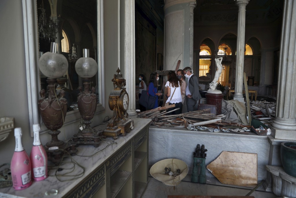 Members of non-governmental international organizations dedicated to the conservation of the world's monuments and sites inspect a room of the 150-yea...