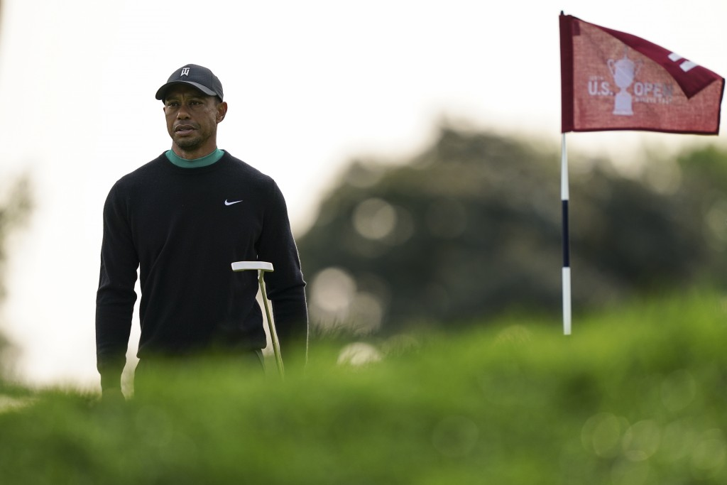 Tiger Woods walks the 11th green during practice before the U.S. Open Championship golf tournament at Winged Foot Golf Club, Tuesday, Sept. 15, 2020, ...