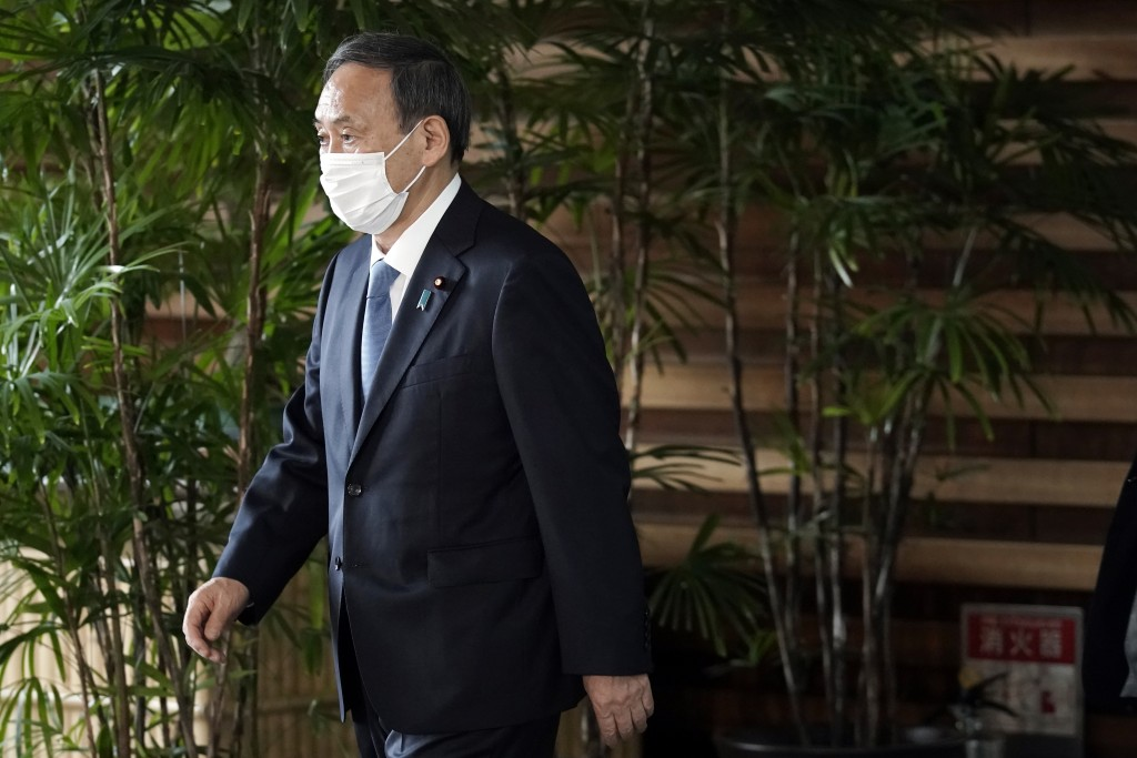 Former Chief Cabinet Secretary Yoshihide Suga walks out of the prime minister's office after a cabinet meeting Wednesday, Sept. 16, 2020, in Tokyo. Pr...