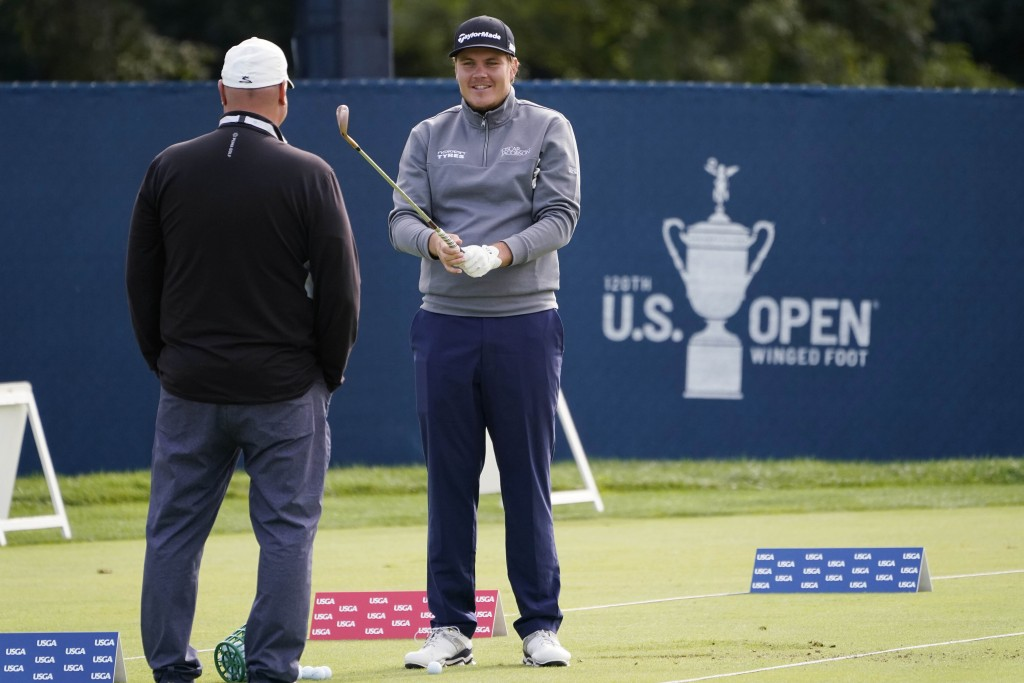 Sami Valimaki, of Finland, talks with his swing coach while practicing for the U.S. Open Championship golf tournament, Tuesday, Sept. 15, 2020, at the...