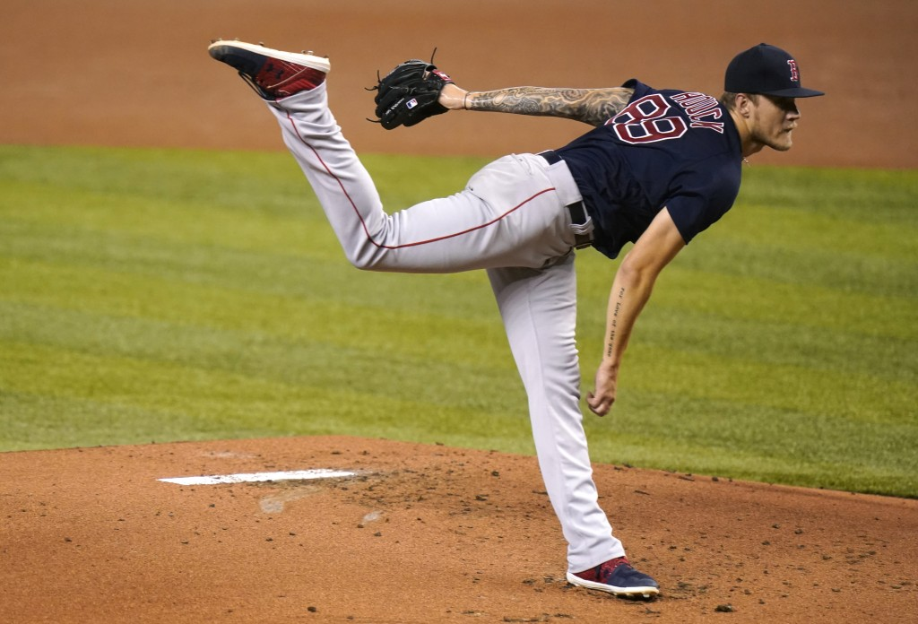 Boston Red Sox starting pitcher Tanner Houck follows through on a delivery during the first inning of a baseball game against the Miami Marlins, Tuesd...