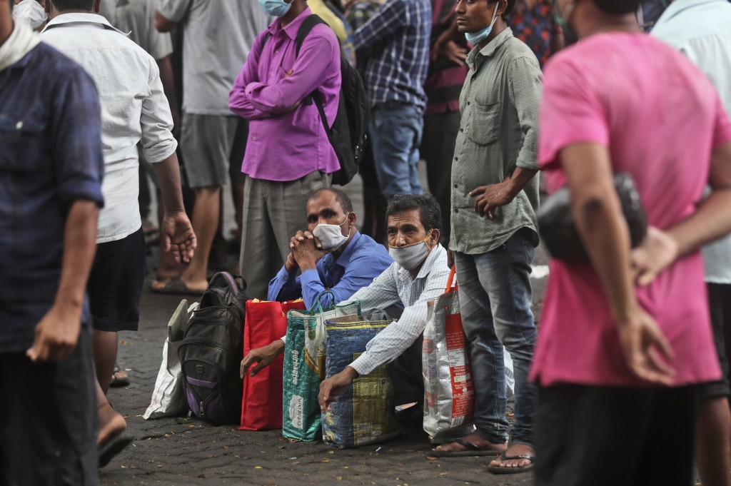 Daily wage laborers wait to get hired for the day in Mumbai, India, Wednesday, Sept. 16, 2020. India's total of coronavirus infections passed 5 millio...