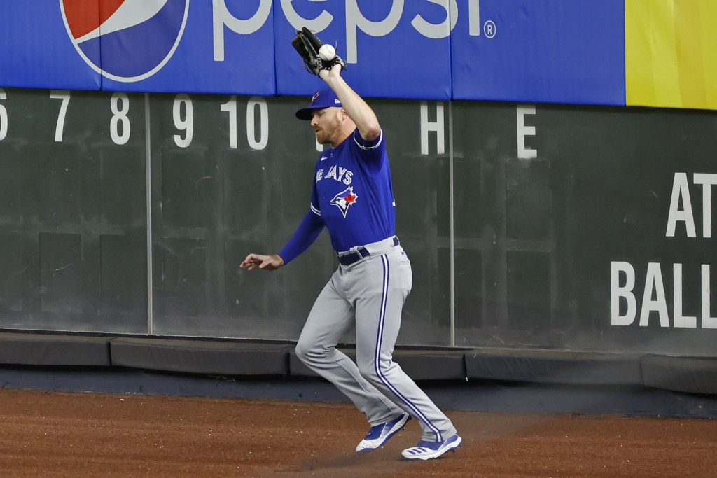 Toronto Blue Jays right fielder Derek Fisher misses the catch on a ball hit by New York Yankees' Clint Frazier during the second inning of a baseball ...