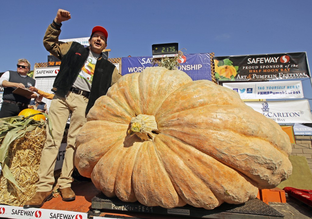 FILE - Leonardo Urena of Napa, Calif., reacts after learning his pumpkin weighed in at 2,175 lbs., a new California weight record on Oct. 14, 2019, in...