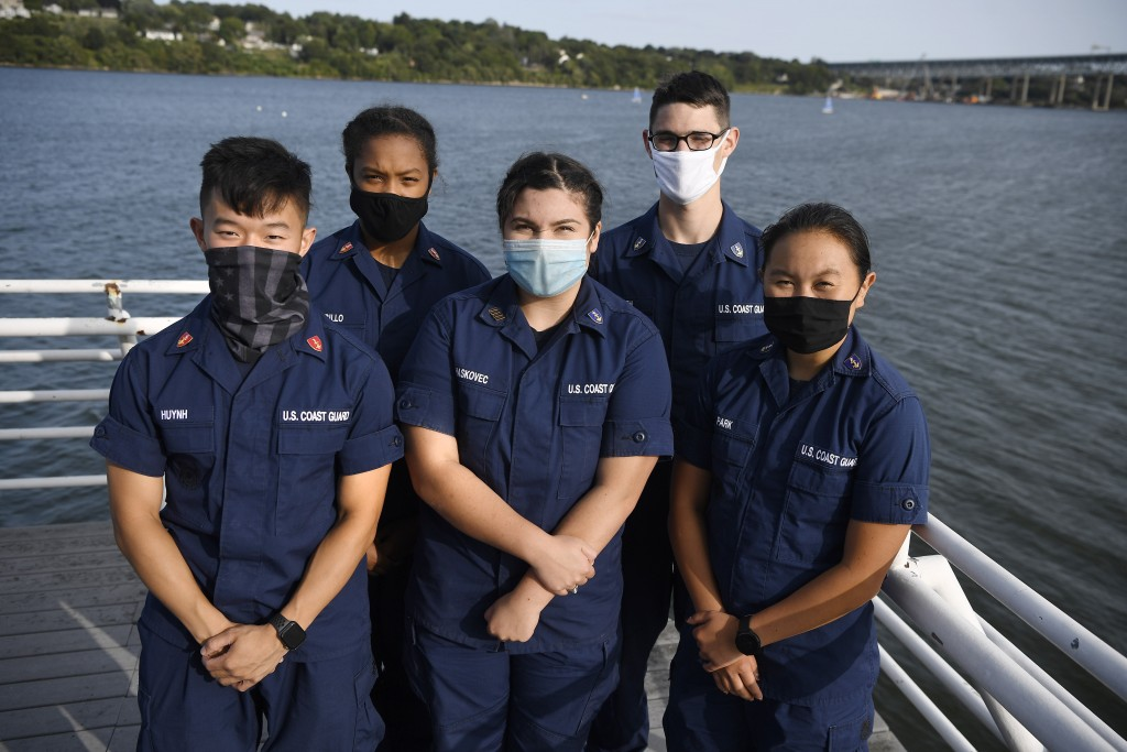 In this Monday Sept. 14, 2020 photo, From the left, Coast Guard Academy Cadets Tyler Huynh, Branyelle Carillo, Mia Haskovec, Henry Smith, and Jordan P...